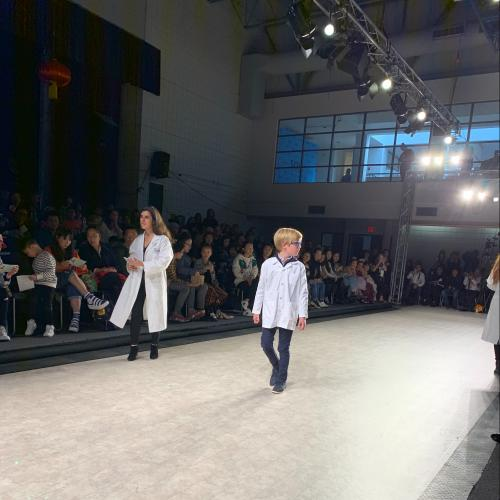 a young boy walks down the runway at Vancouver Kids Fashion Week